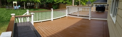 Trex composite decking, white rails, and custom bar top