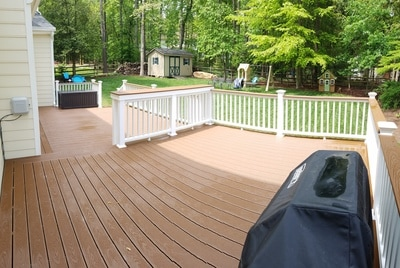 multi-level trex deck with custom bar top, and white railings